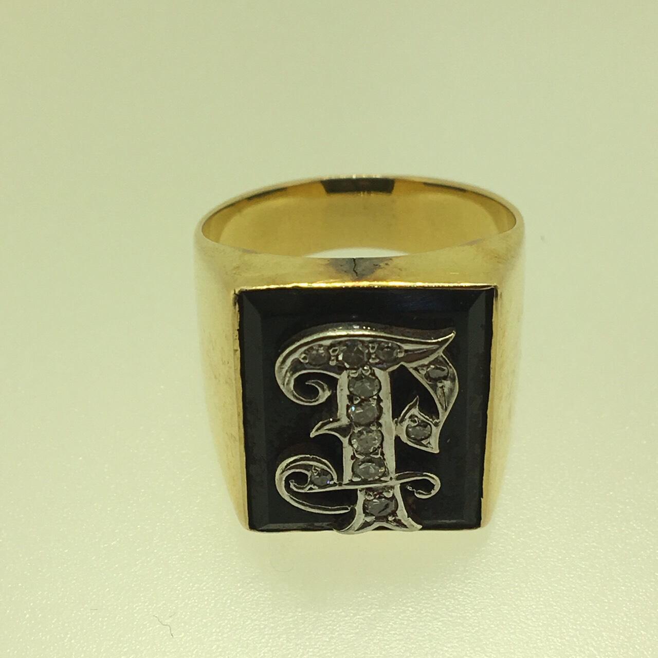 รับซื้อแหวนตัวอักษรฝังเพชร