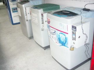 เครื่องซักผ้าระบบหยอดเหรียญ