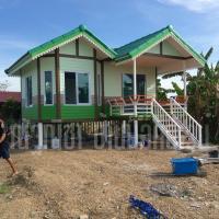 บ้านน็อคดาวน์ หลังคาทรงจั่วประยุกต์ ขนาดพื้นที่ 26 สีเขียว
